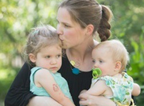 photo of Dr. Kealy Mann, ND holding her two children