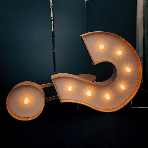 hanging decorative light in the shape of a question mark