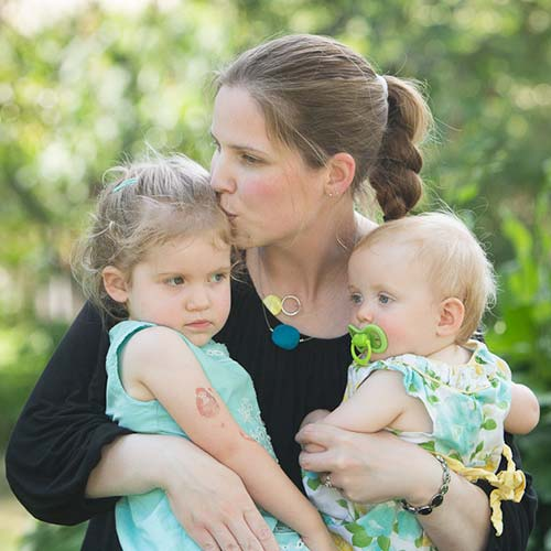 Dr Kealy Mann holding her two children